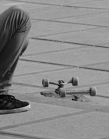 feet beside skateboard